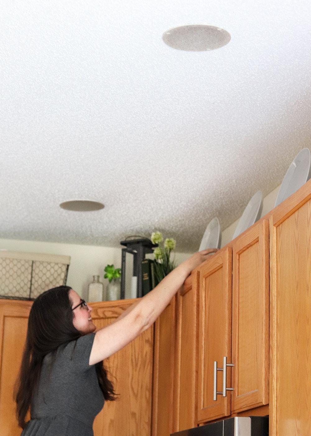 designer Julia Fain decorating with plates over oak cabinets
