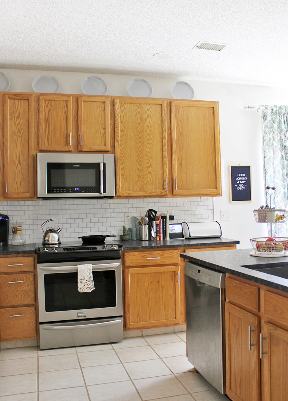Decorating Over Kitchen Cabinets With Plates For Under $60 #kitchendecor  #budgetdecor