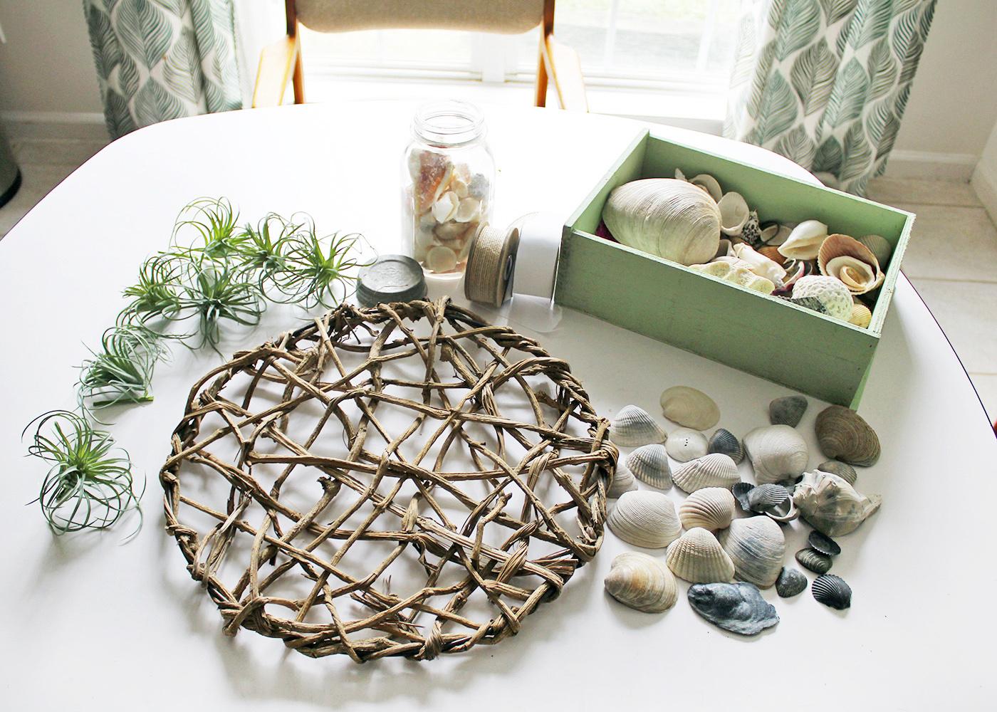 supplies for an air plant wreath with seashells