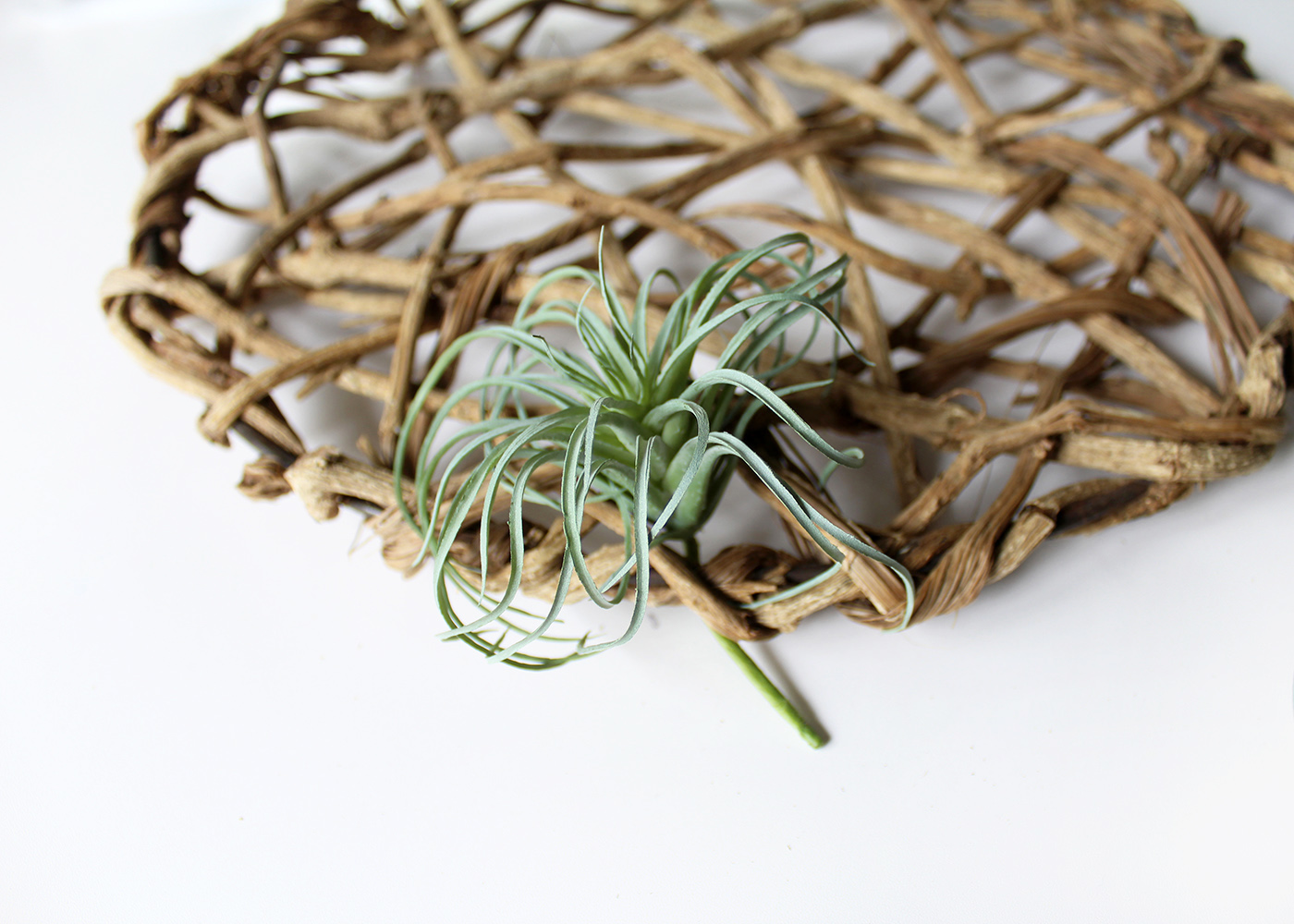 how to attach a faux air plant to a disk wreath