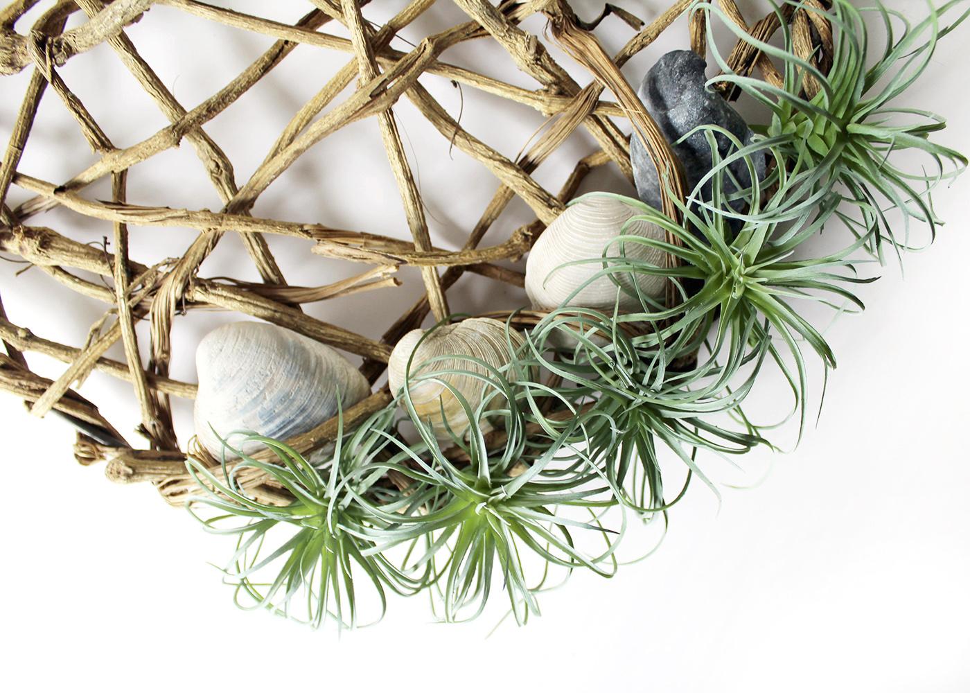 add seashells to vine disk wreath
