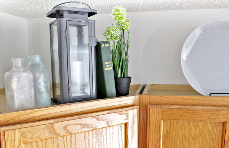 To Decorate Above Kitchen Cabinets, Decorating On Top Of Your Kitchen Cabinets