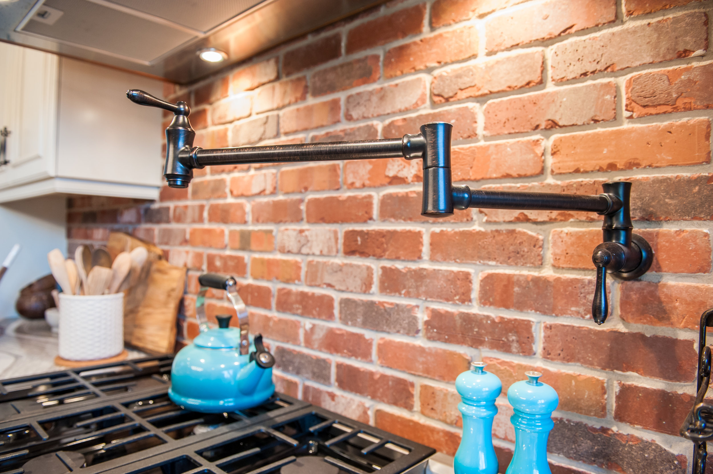 pot_filler_brick_backsplash_kitchen