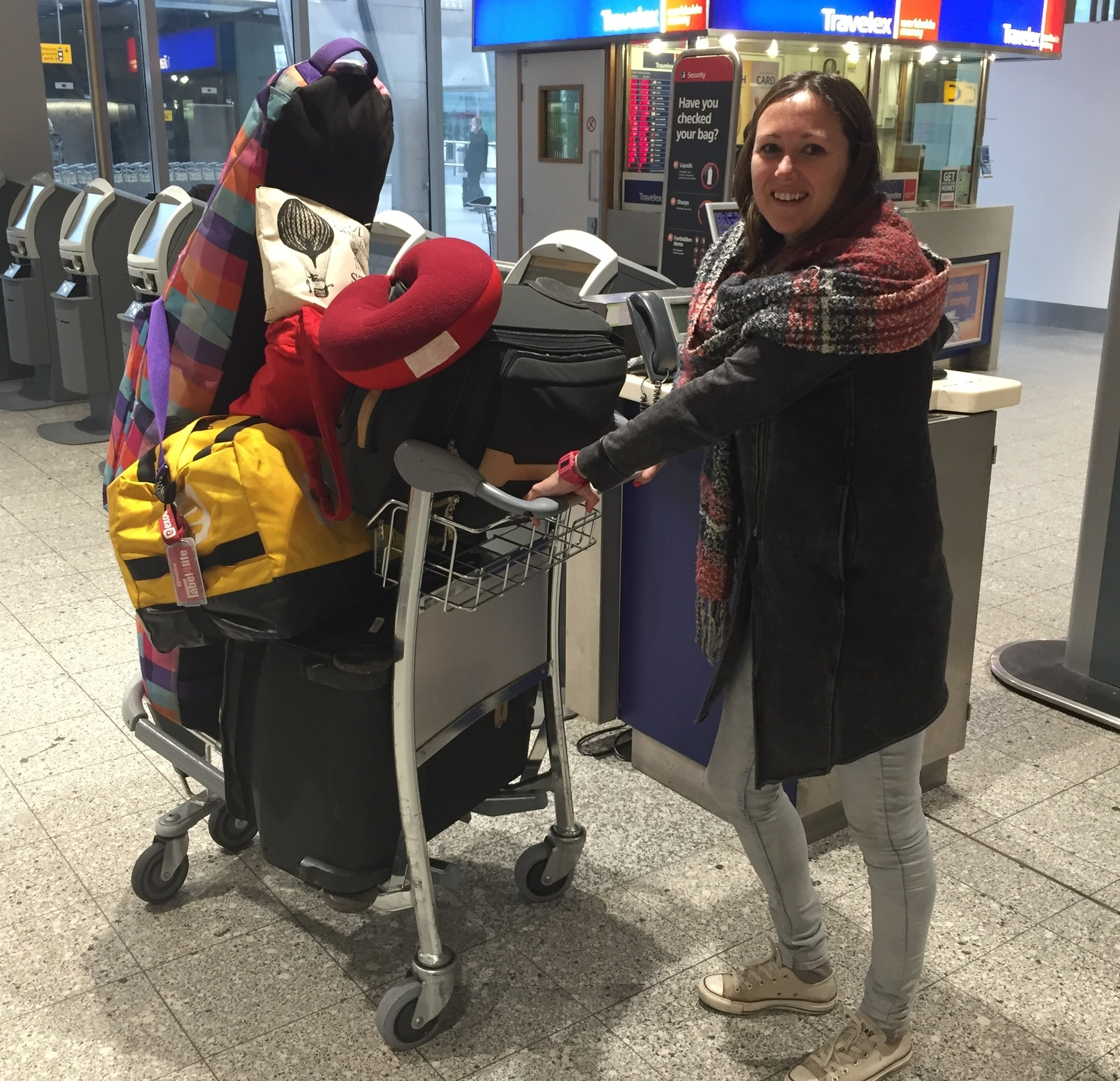 Emma Hodgkins and luggage full of donations