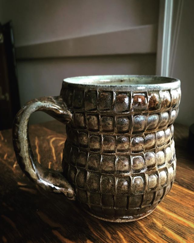 Here is a stamped soda fired mug circa 2010. One huge reason why I fell in love with pottery is because of wood firing. I got to fire the @northernclaycenter kiln at Jeff Oestreich's , I got to fire with Randy Johnston and Jan McKeachie Johnston, kilns at Alfred and Penland and the last shift I did was @joshcopuspottery land shark. This ultimately inspired my love for vapor firings especially soda. I made a body of work that was all stamped because I loved the idea of plaster stamps being tiny molds to add a rhythm to a surface. I guess I did some brown and round pots 🤭