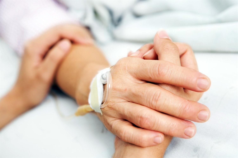 408_hospital_bed_hands.jpg