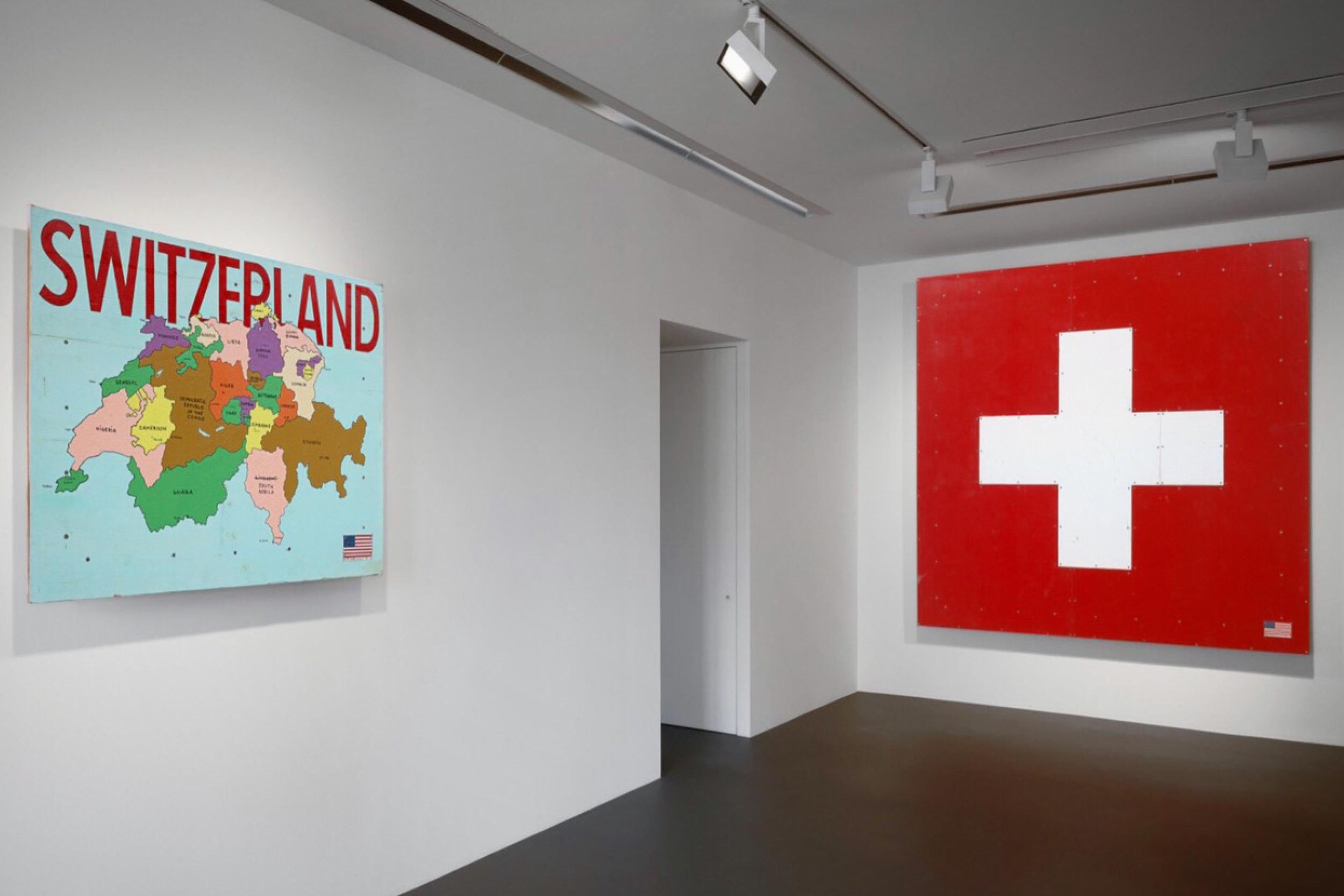 Installation View: Tom Sachs,  The Pack , 2018 - 2019. Vito Schnabel Gallery, St. Moritz, Switzerland / Left -  Switzerland  (2018) ; Right -  Flag  (2018) © Tom Sachs
