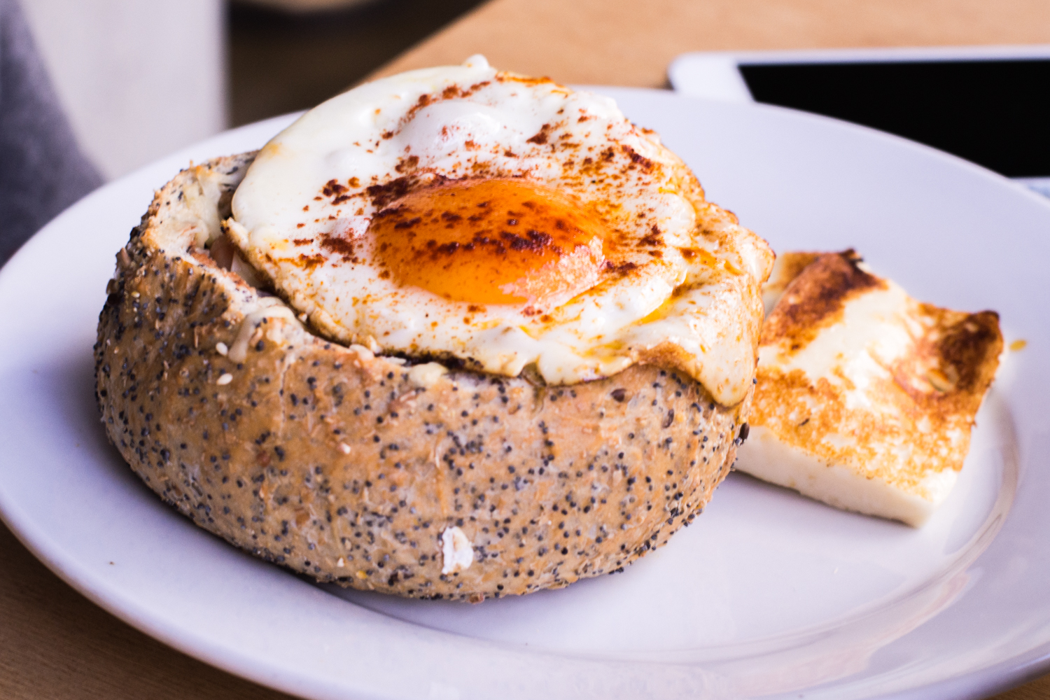 Oven baked beans in roll: served in a seeded roll with grated parmesan cheese, avocado and a fried egg - $15.00