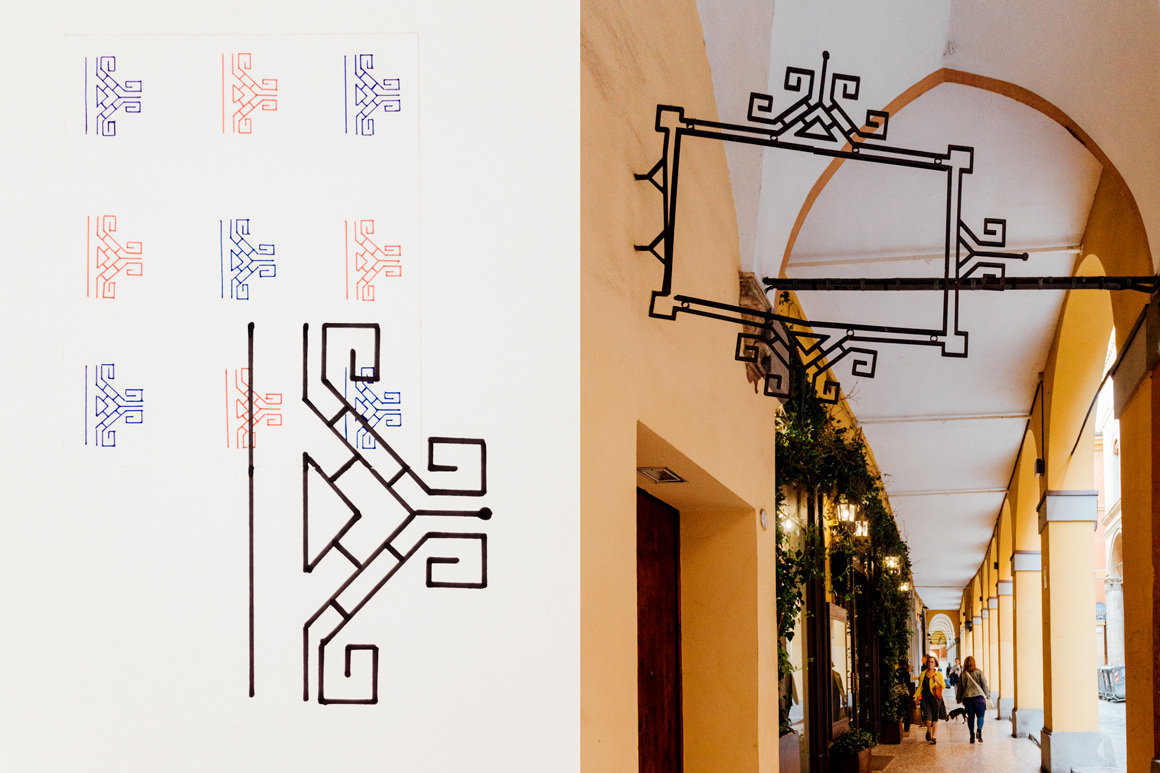 D _ by Marco Trevisani  Wall iron decoration  The letter D takes inspiration from the geometric motif of a metal frame decoration hanging under one of the many porticos of the city. (Paper, ink pens)