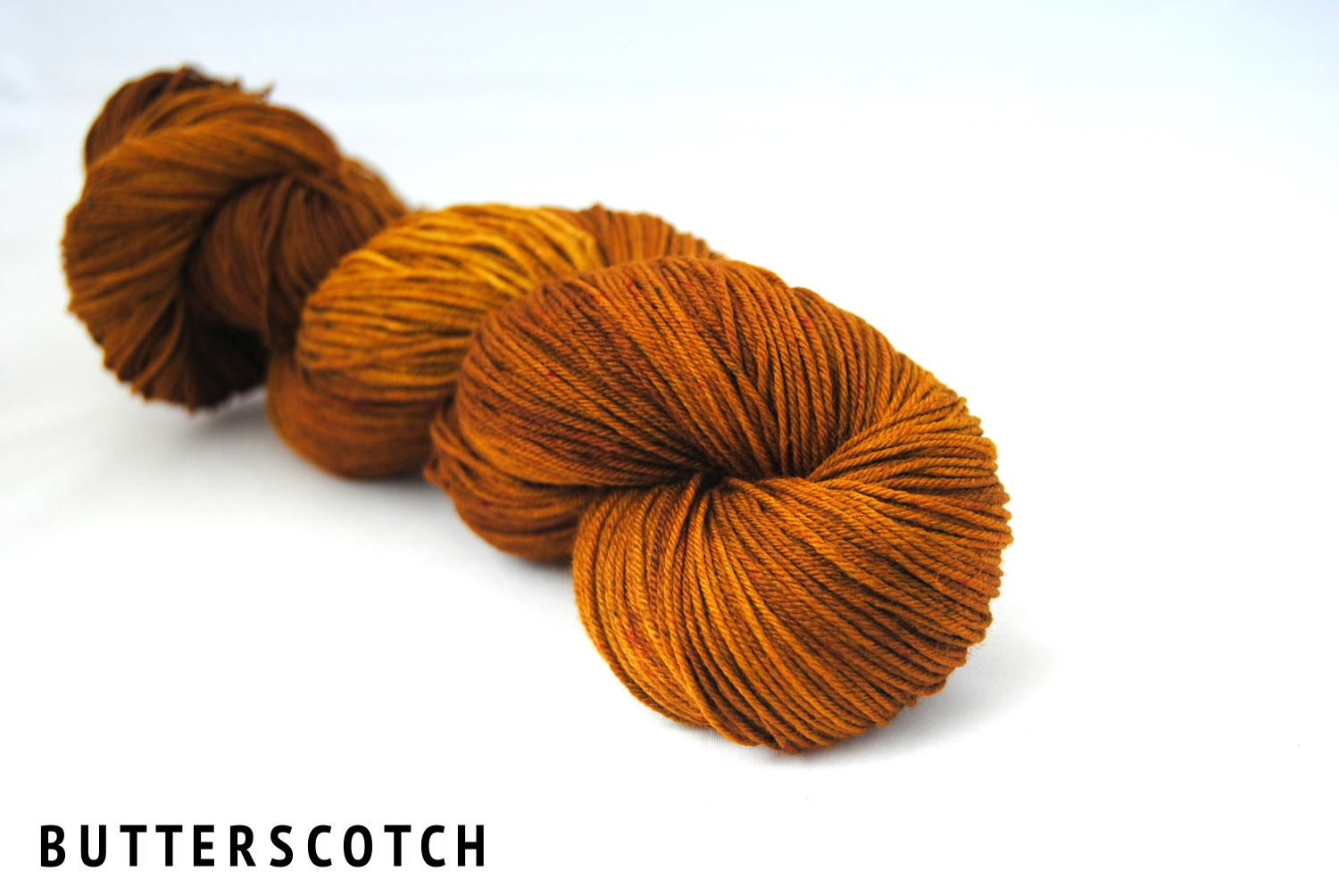 BUTTERSCOTCH on superwash merino nylon fingering.jpg