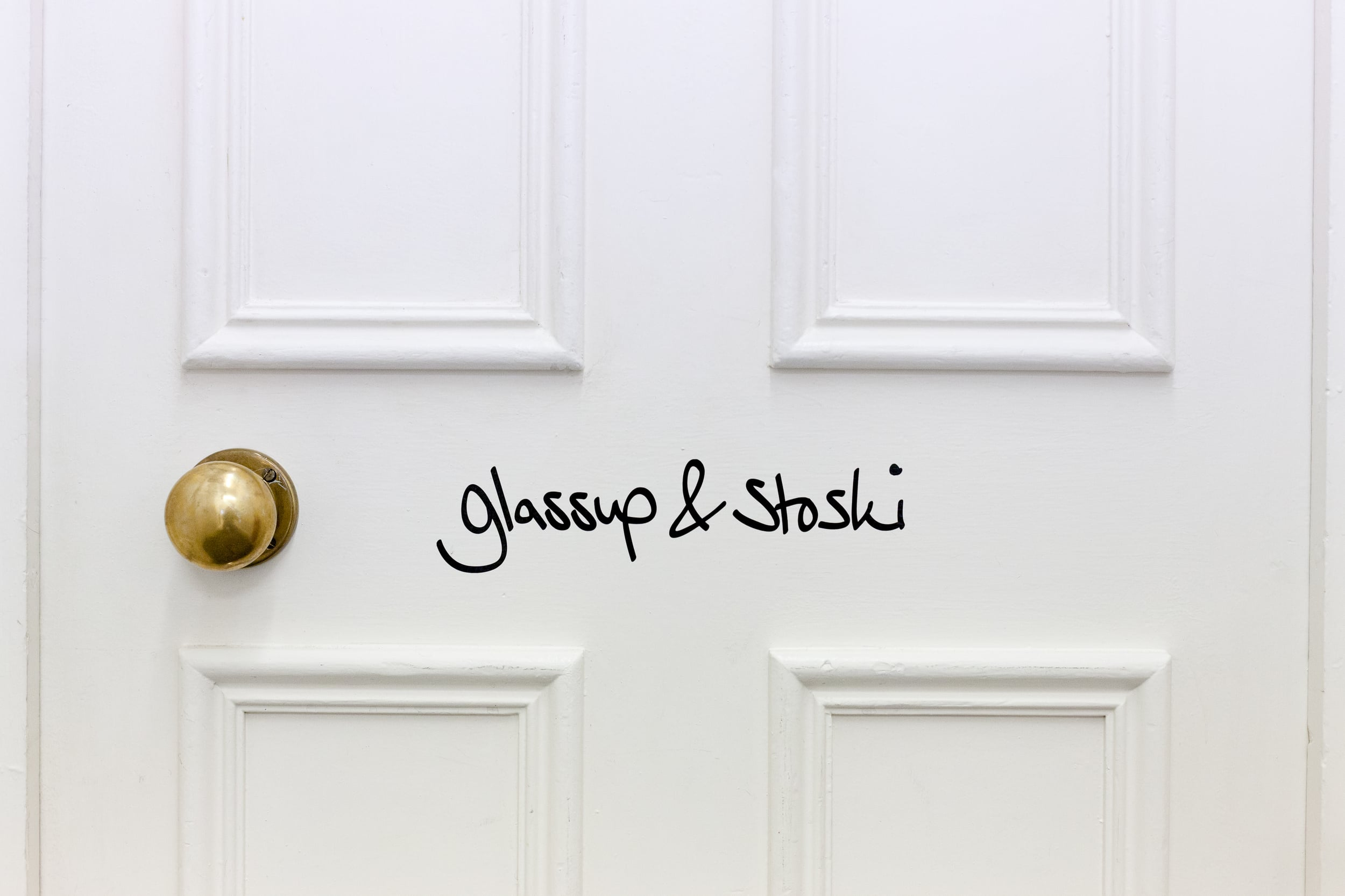 Glassup & Stoski White Door Sign.jpg