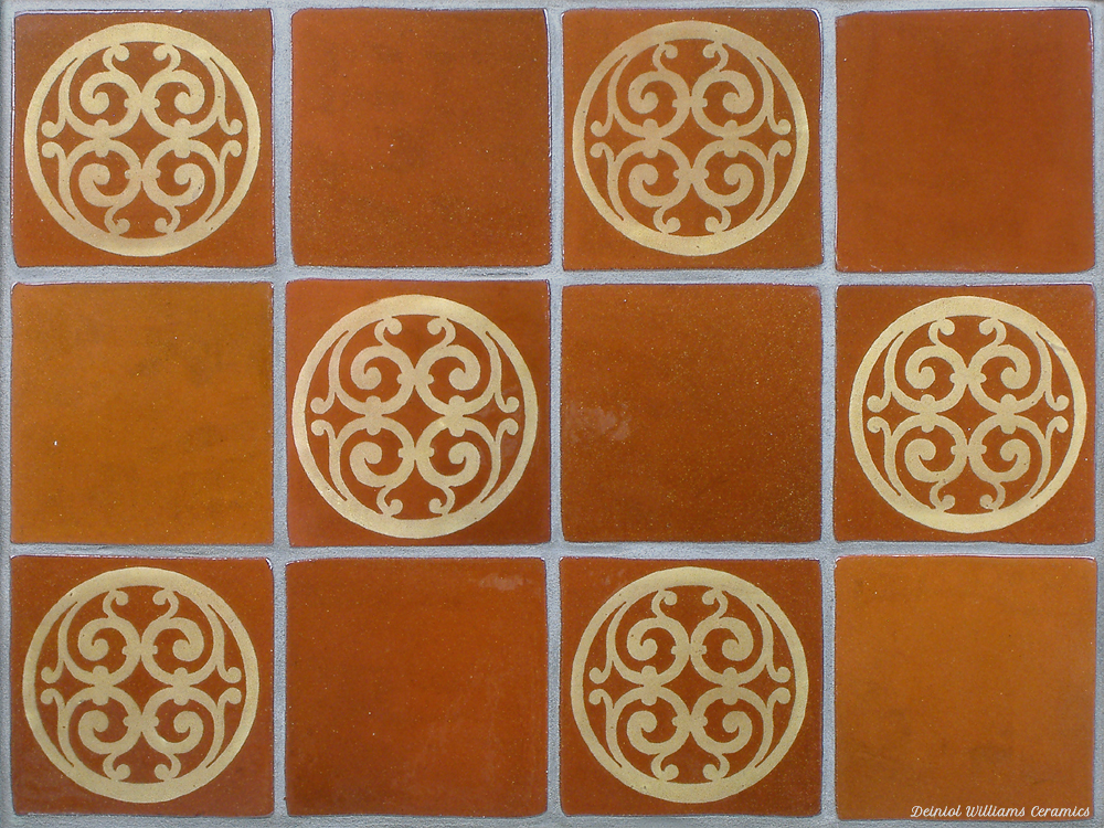 Terracotta wall tiles with designs based on original medieval tiles