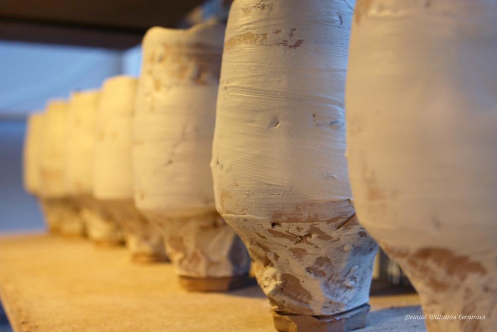 Carved vessels with a coat of slip