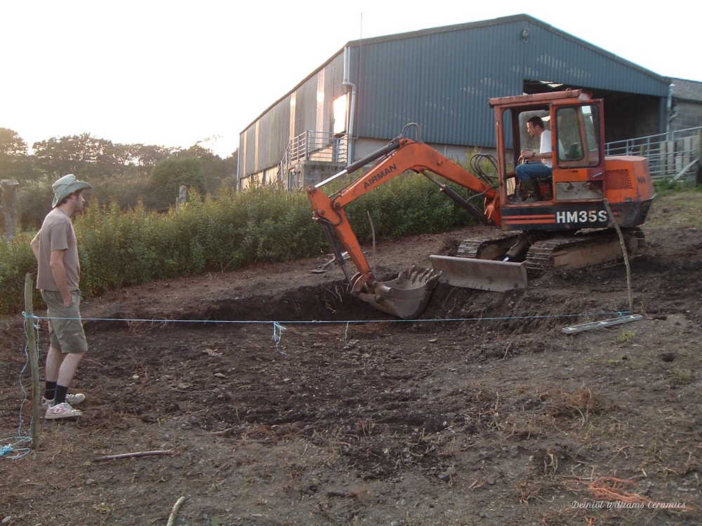 Preparing groundworks for the wood kiln and shelter