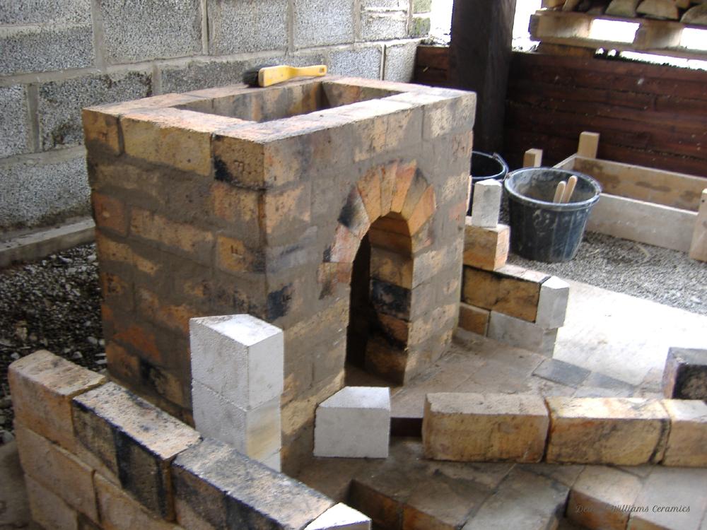 Woodkiln flue and chimney base construction