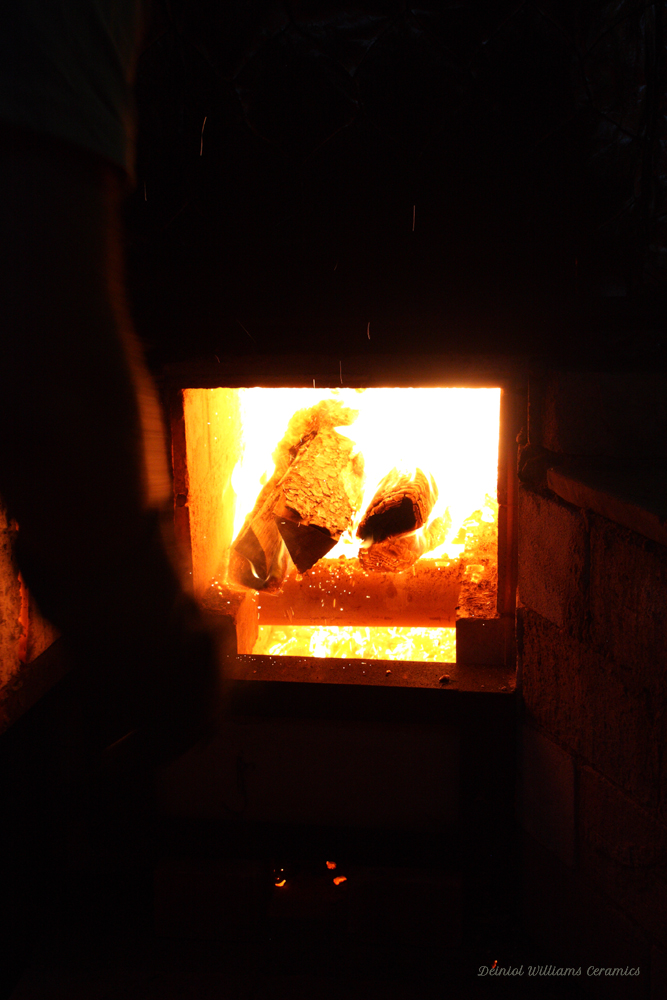 Placing wood in the firebox