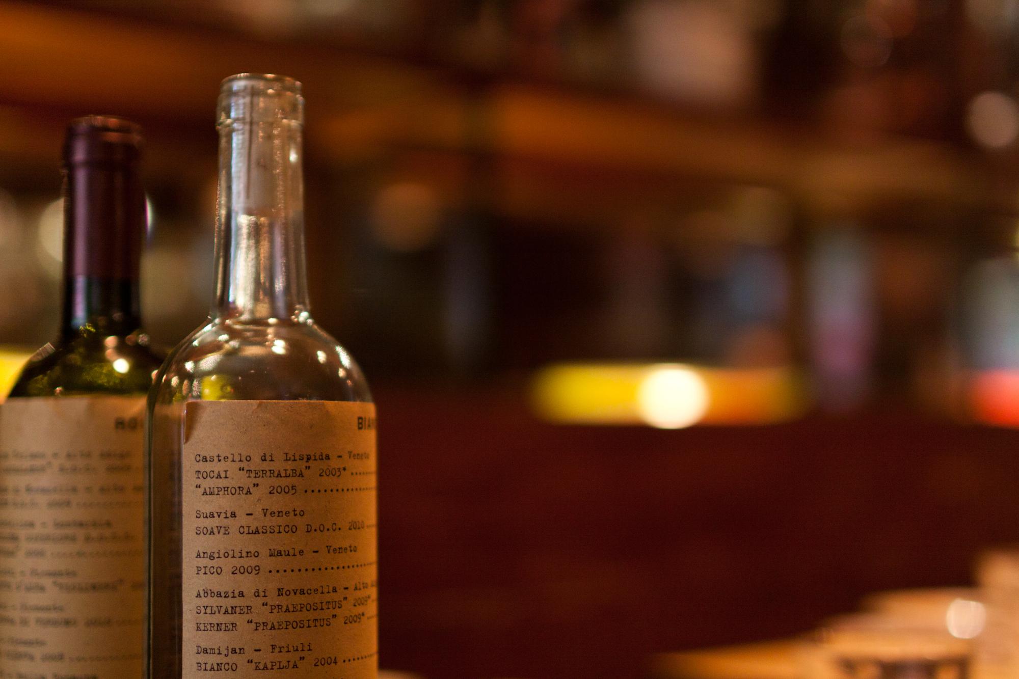 Wine menus printed on empty wine bottles