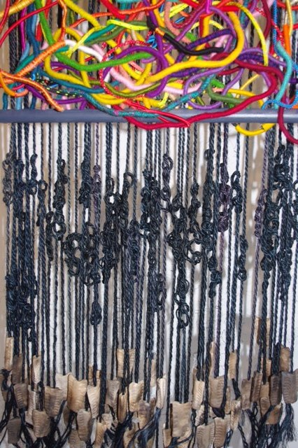 'Tangled Threads 3' Dyed and warp-wrapped sisal,  Burnished and smoke-fired clay Mixed yarns. Similar work £600-700.