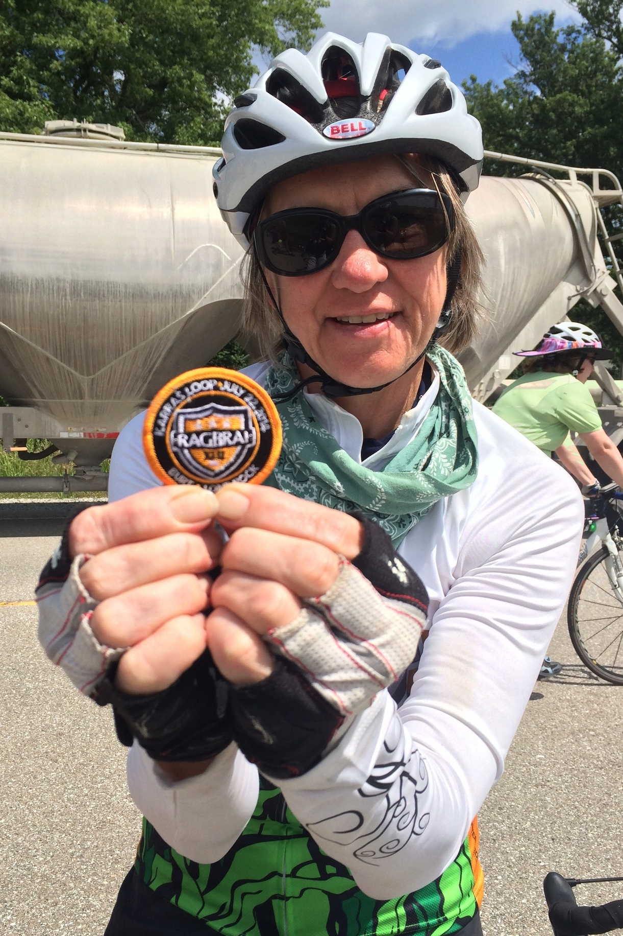 Tracy holding the patch given to riders who complete the Karras loop - over 100 miles in one day!