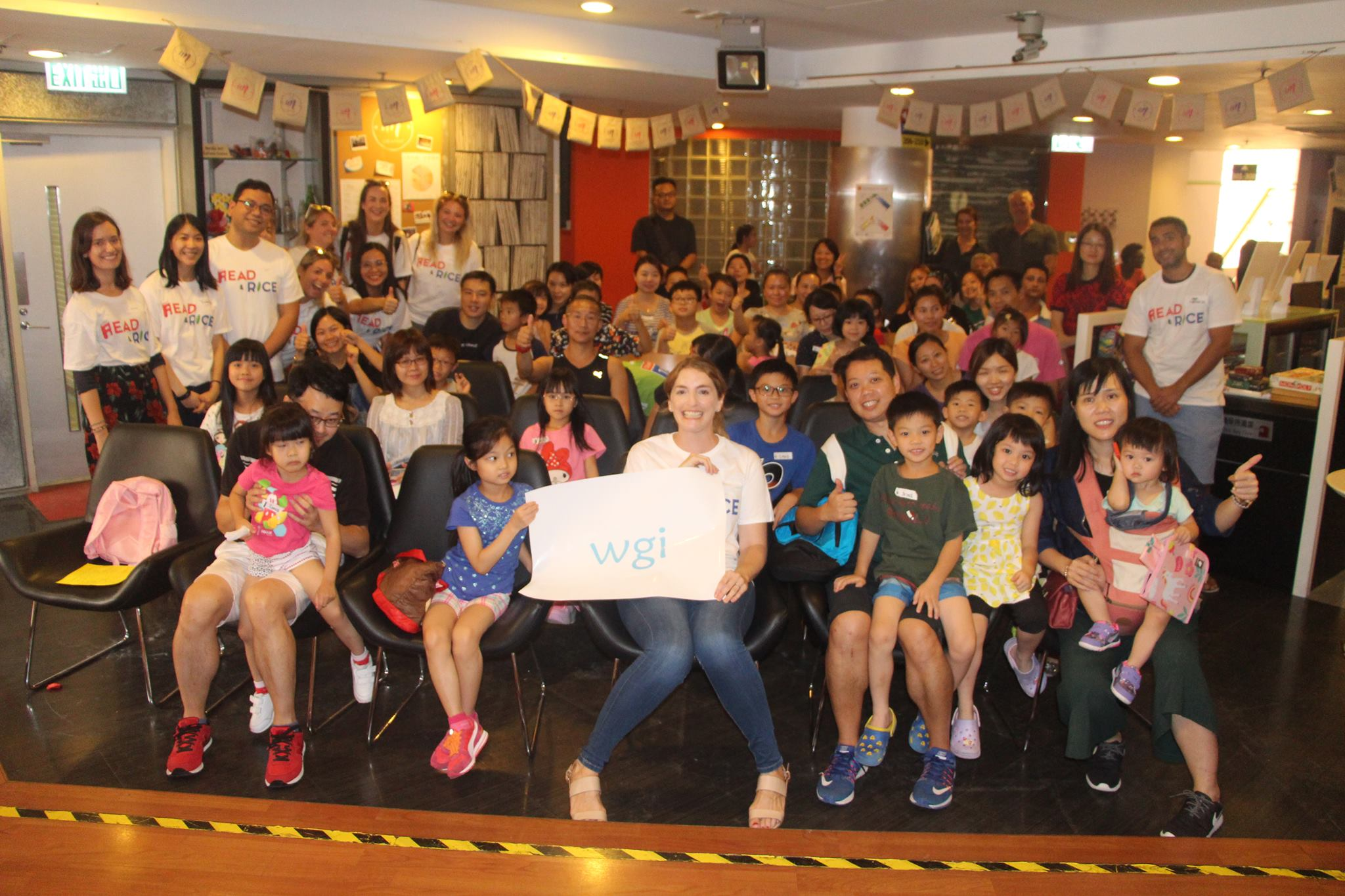 Volunteers and students pose at the launch of Read and Rice in Hong Kong.