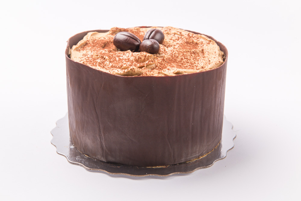 Cappuccino Chiffon   Layers of light chiffon cake, topped with chocolate espresso mousse and wrapped in chocolate.