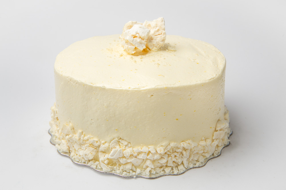 Lemon Chiffon   Light layers of moist chiffon cake with tart lemon curd. Iced in lemon buttercream and topped with chunks of meringue.