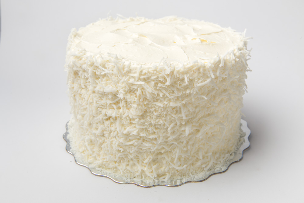Lemon Coconut Snowball   Vanilla cake, homemade lemon curd and creamy coconut frosting all wrapped in shredded coconut.