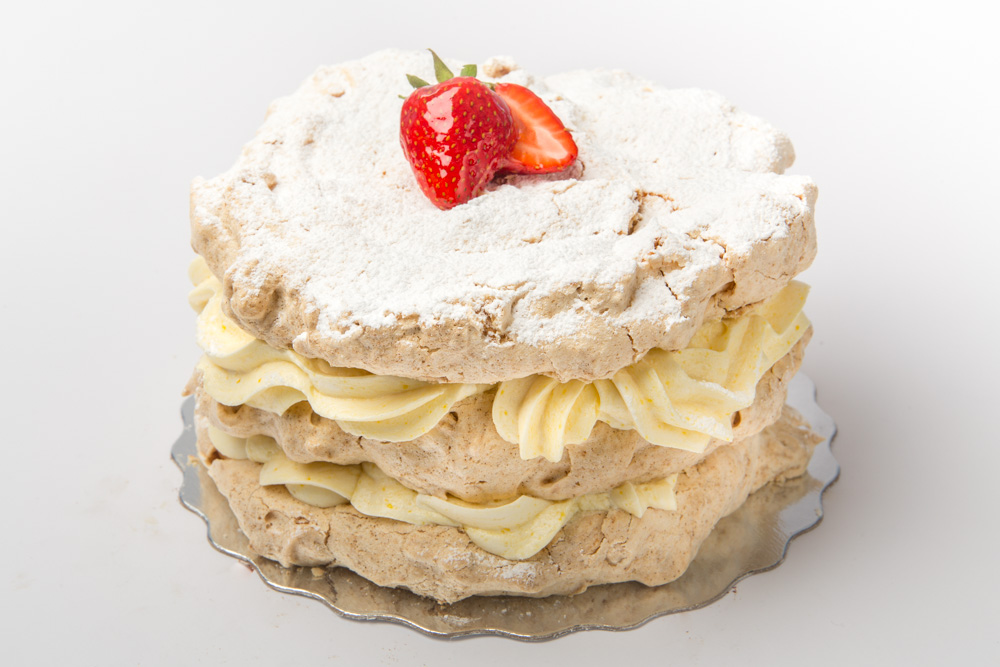 Lemon Meringue   Layers of crunchy meringue and our luscious, tangy lemon buttercream. Also available in Mocha flavour.