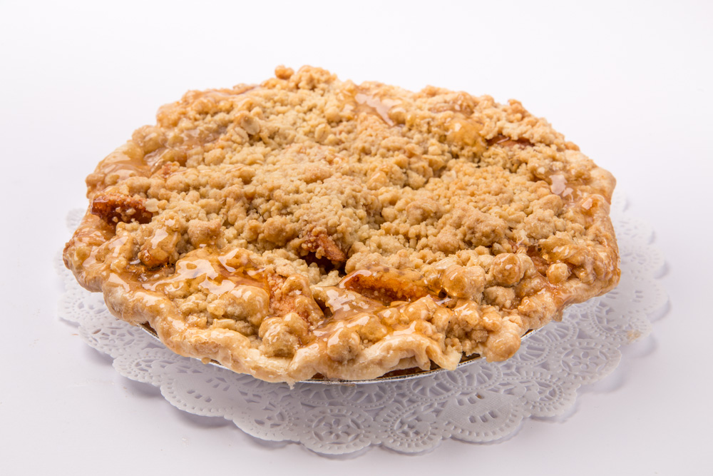 Apple Crumble   Flaky pastry baked with fresh apples, cinnamon and sugar and topped wtih butter crumble.
