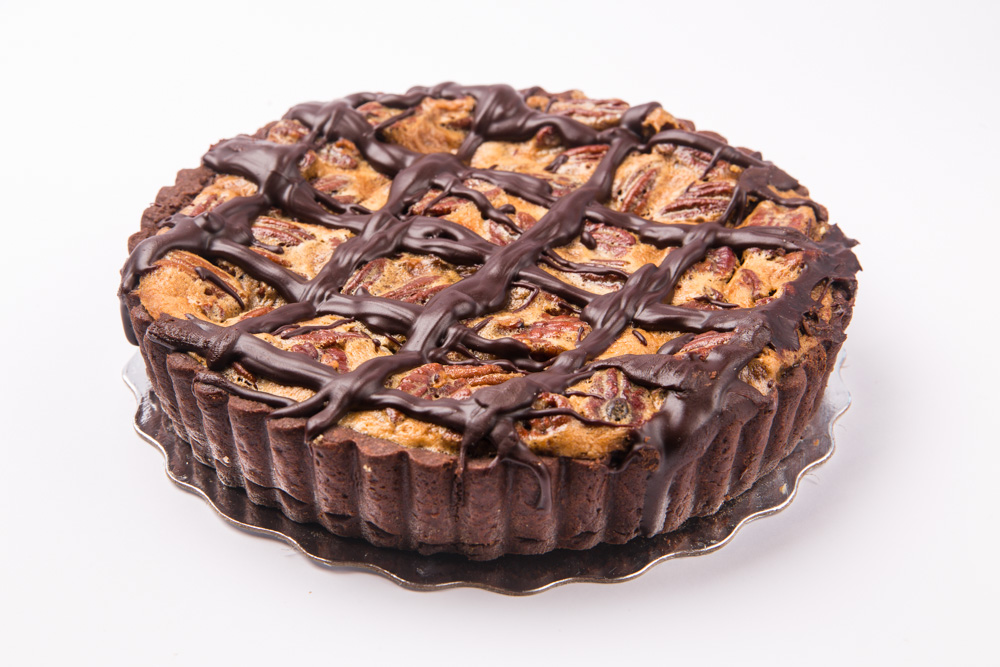 Chocolate Pecan Pie   An award winner! Pecan pie baked in a chocolate crust and topped with fudge frosting.
