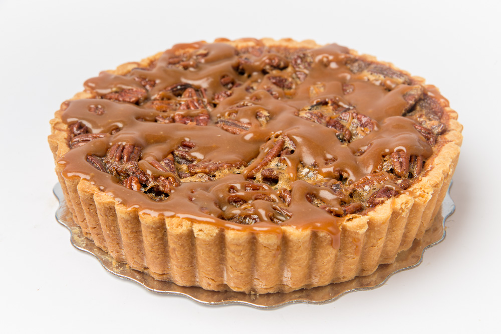 Caramel Pecan   Brown sugar and butter filling baked with toasted pecans and topped with homemade caramel.