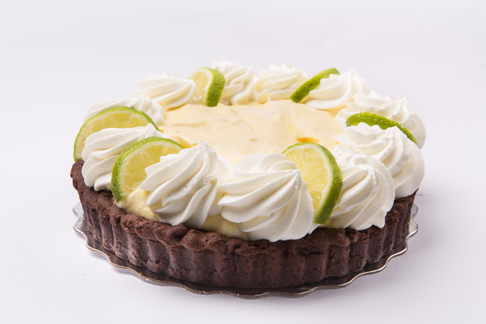Keylime White Chocolate Mousse Pie   Keylime white chocolate mousse pie heaped into a chocolate or plain pastry crust.