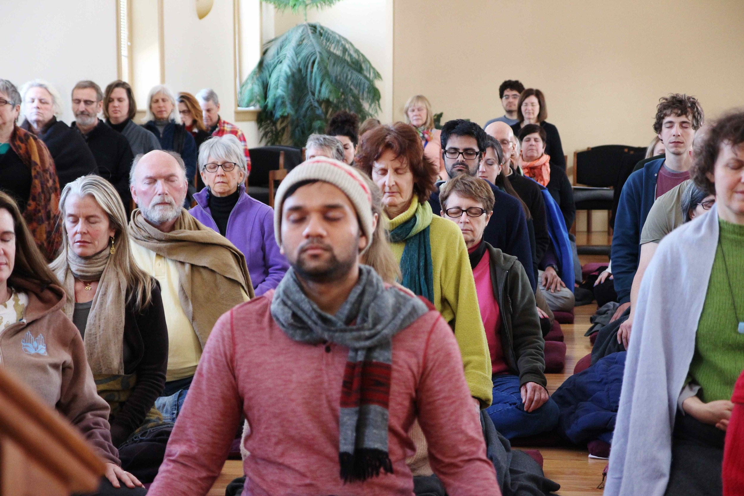 The last sit of a wonderful retreat (that's me in the back row in the blue sweater). Photograph by Evan Henritze. Courtesy of the  Insight Meditation Society .