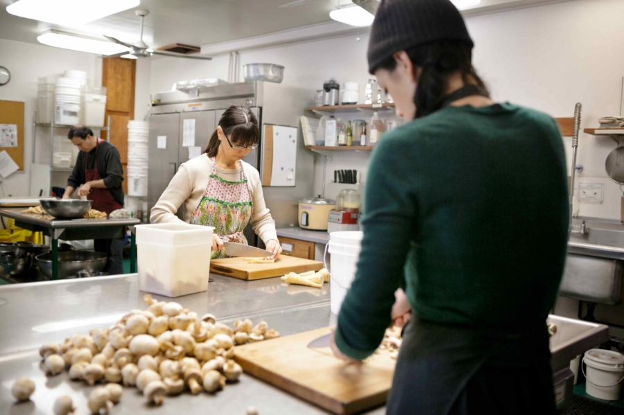 My friends Sabra, Kim, and Brian lovingly prepare a meal at the IMS Retreat Center. Photo by  Willie Davis