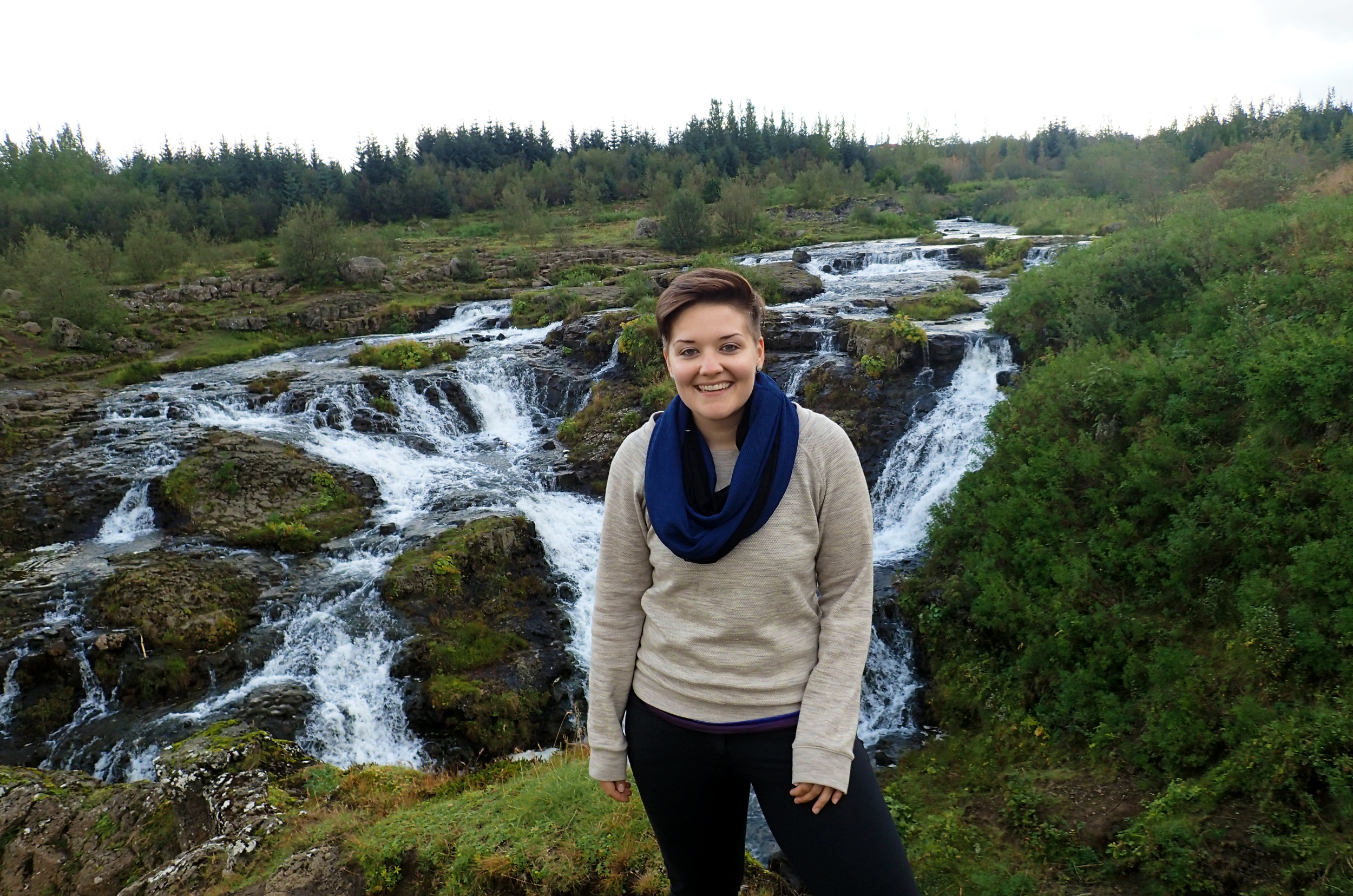 I am a one day old traveler here, standing in front of a small waterfall in Breiðholt,  Iceland