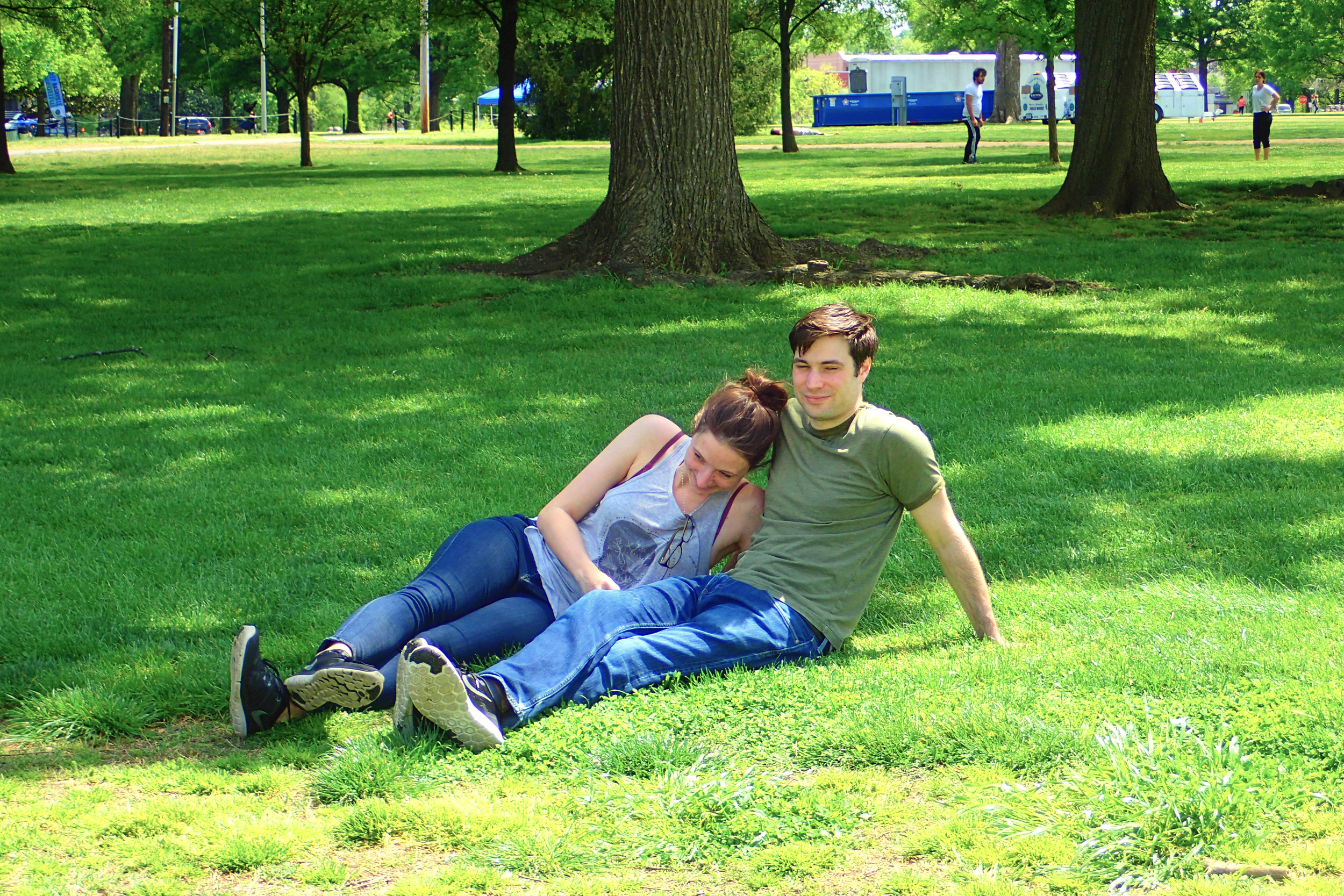 Jess and James lounging on the grass in Nashville