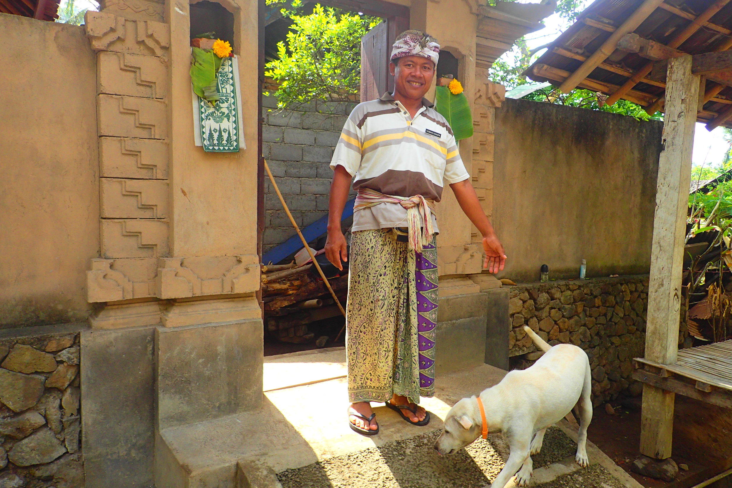 My Tenganan village guide in Bali with his family dog.