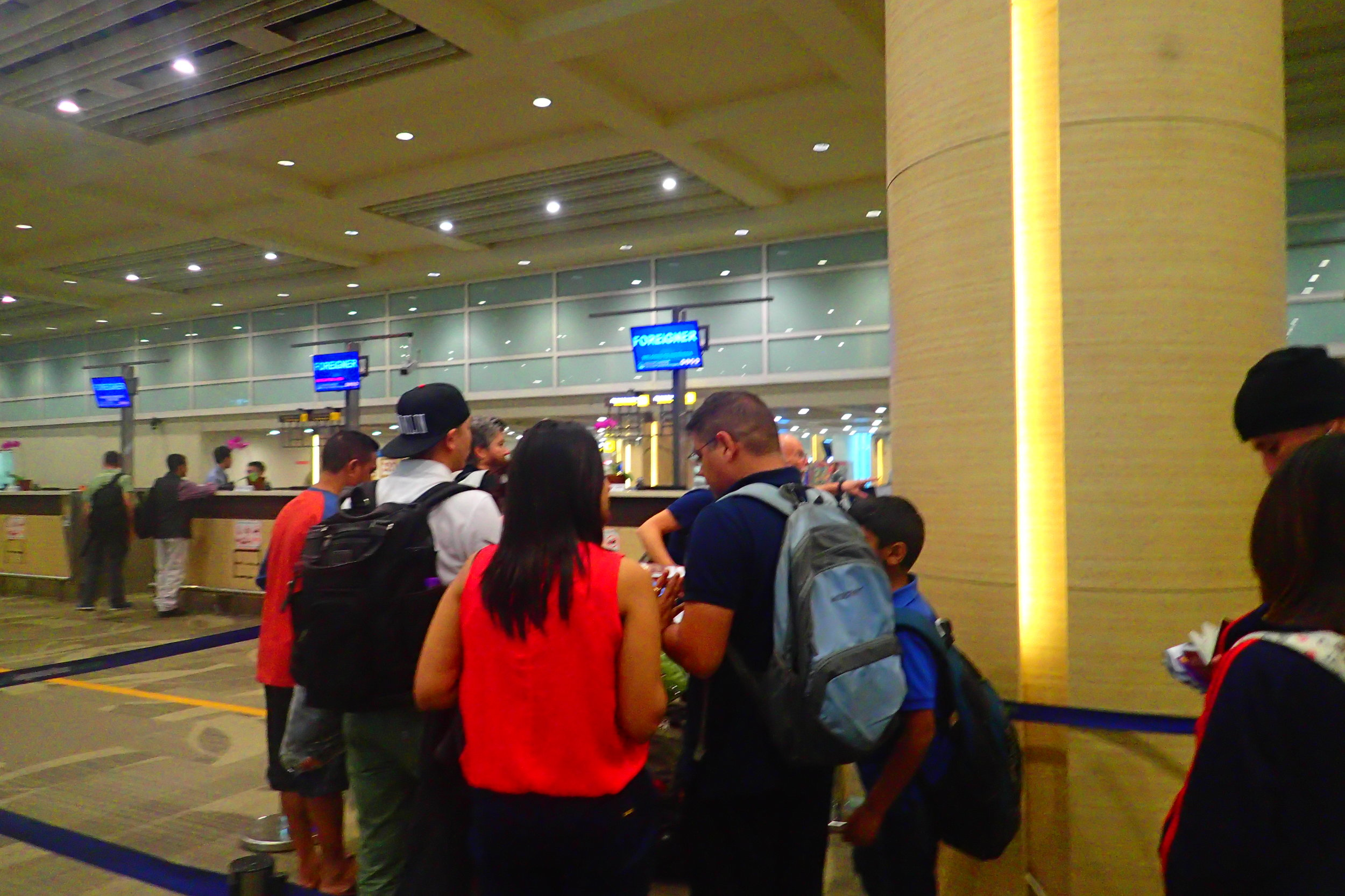 This is a shot at customs entering Bali. Losing your passport while abroad would be a much bigger problem than your ID while domestic.
