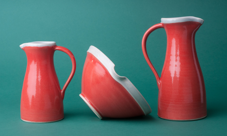 Topsy Jewell red ceramic jugs and bowl photographed by Katie Vandyck