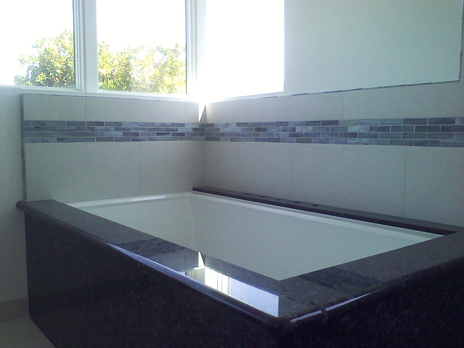 Ken and his crew are awesome! My oddly shaped bathroom was a challenge, but they did a fantastic job. They were great fun to have around too.  -  Kaethe Sullivan