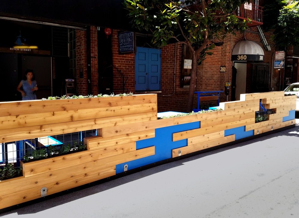 Little Skillet - Versatile seating and a pop of color draw people into this alleyway gem