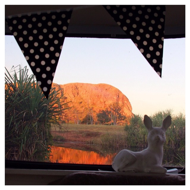 Wow! An absolutely breathtaking view out of my van's back window ... The rock is all lit up by the afternoon sunlight, and reflecting into the water. Awesome.