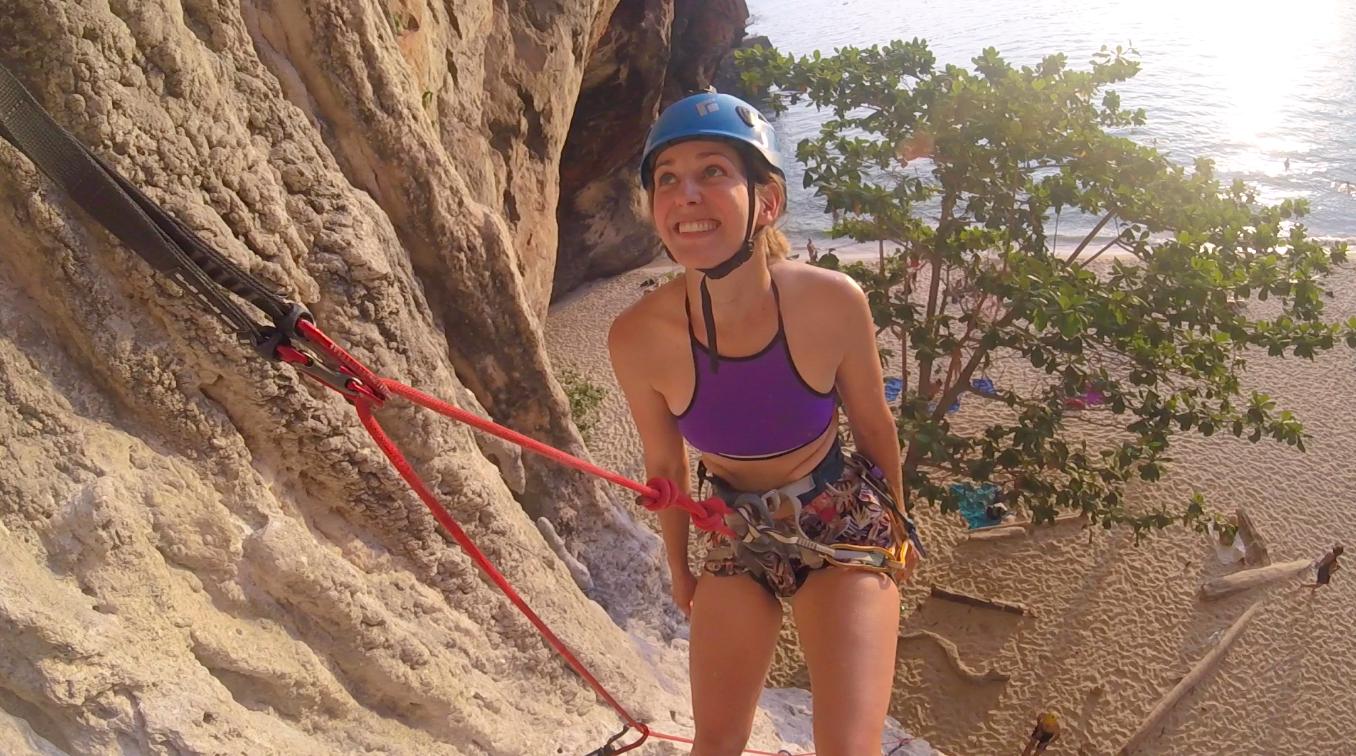 Nicole Rowles rock climbing.png