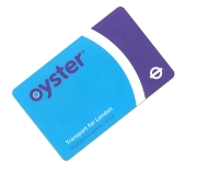 Oyster card - London buses no longer accept cash. You have to use an Oyster card, or a contactless card.