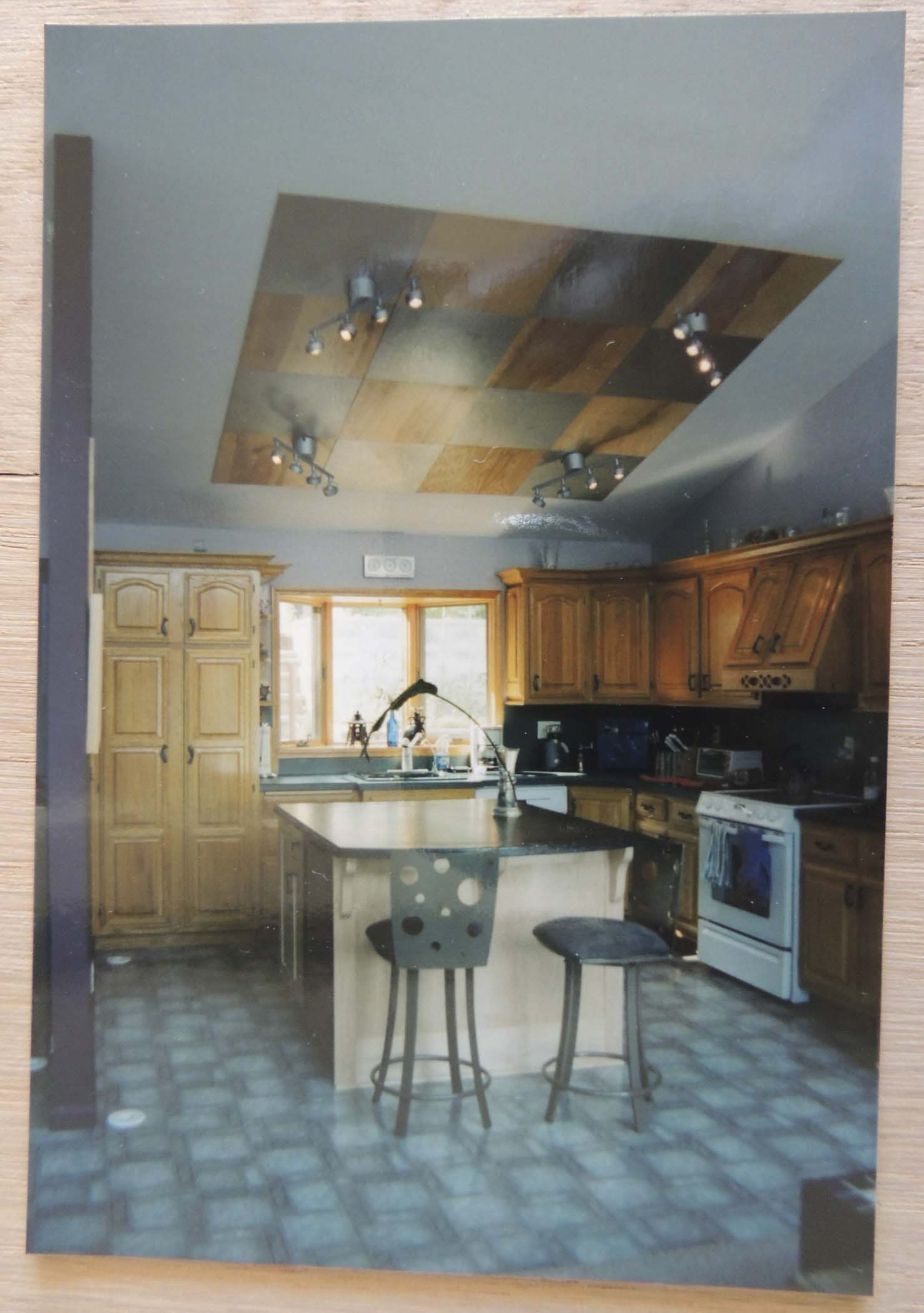 Our kitchen in 2002, with the island we had made for us and lights from IKEA installed over a checkerboard of panels we used to hide holes in the drywall.