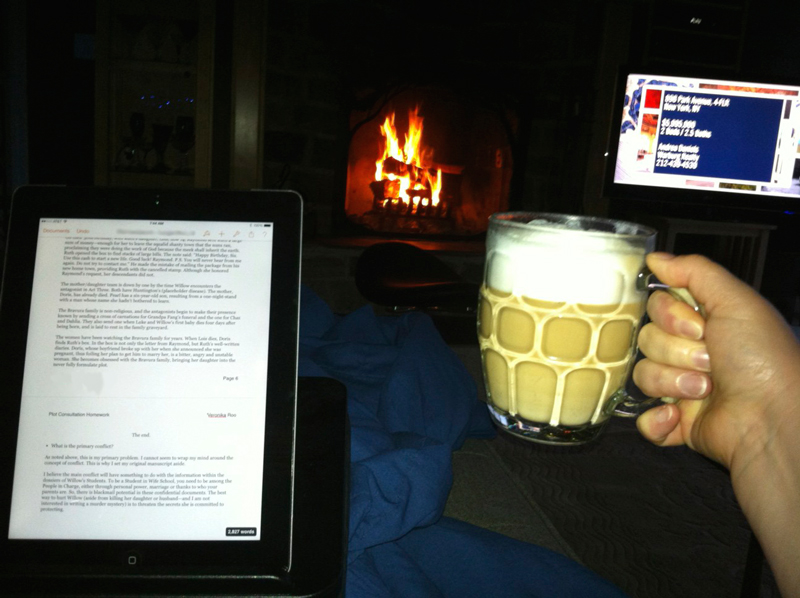 Cozy under a blanket, in front of the fire, iPad on my lap, husband-made cappuccino in my hand.