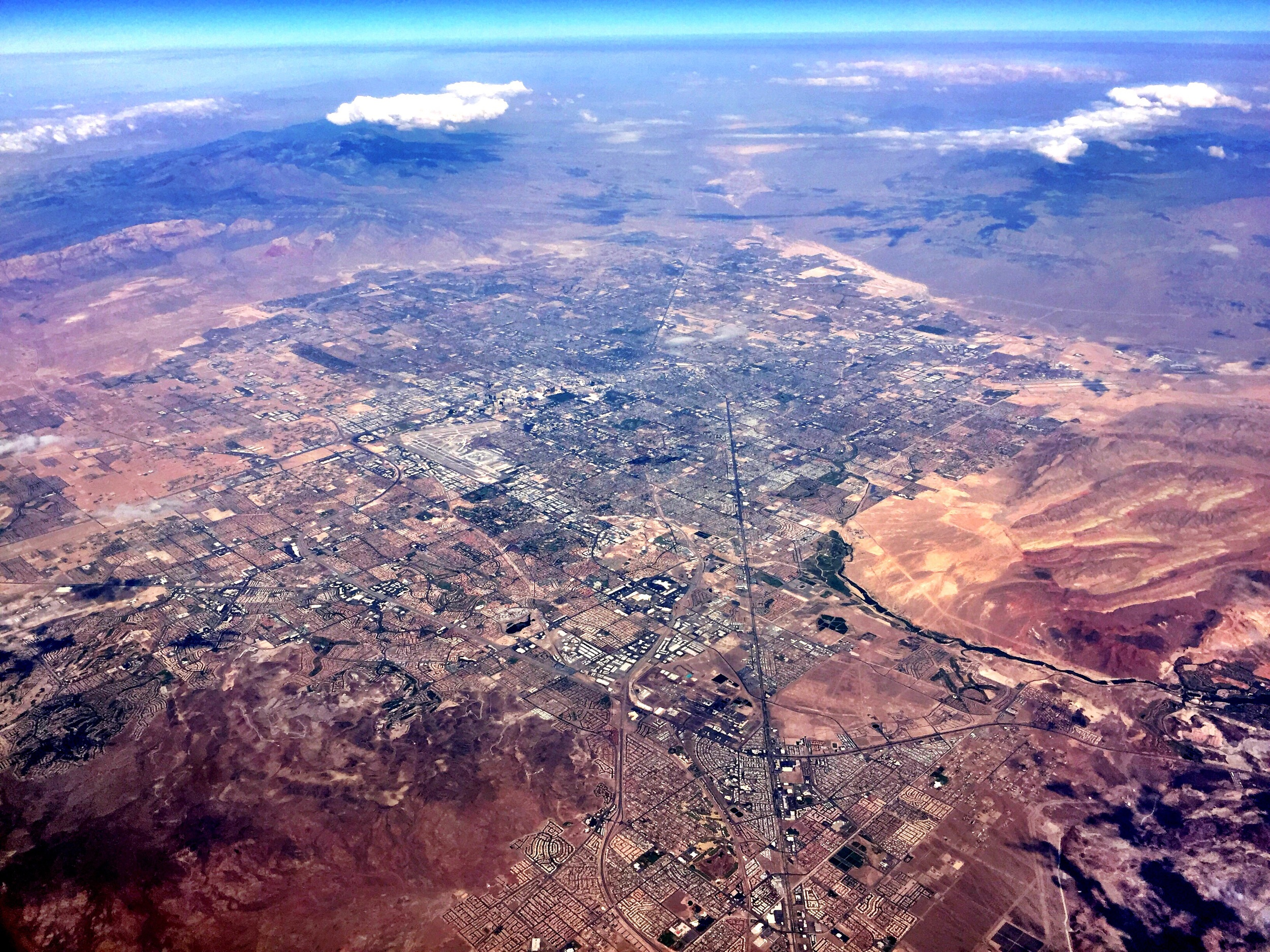 Over Boulder City, Nevada, with a view of Las Vegas at 1:30 PM.