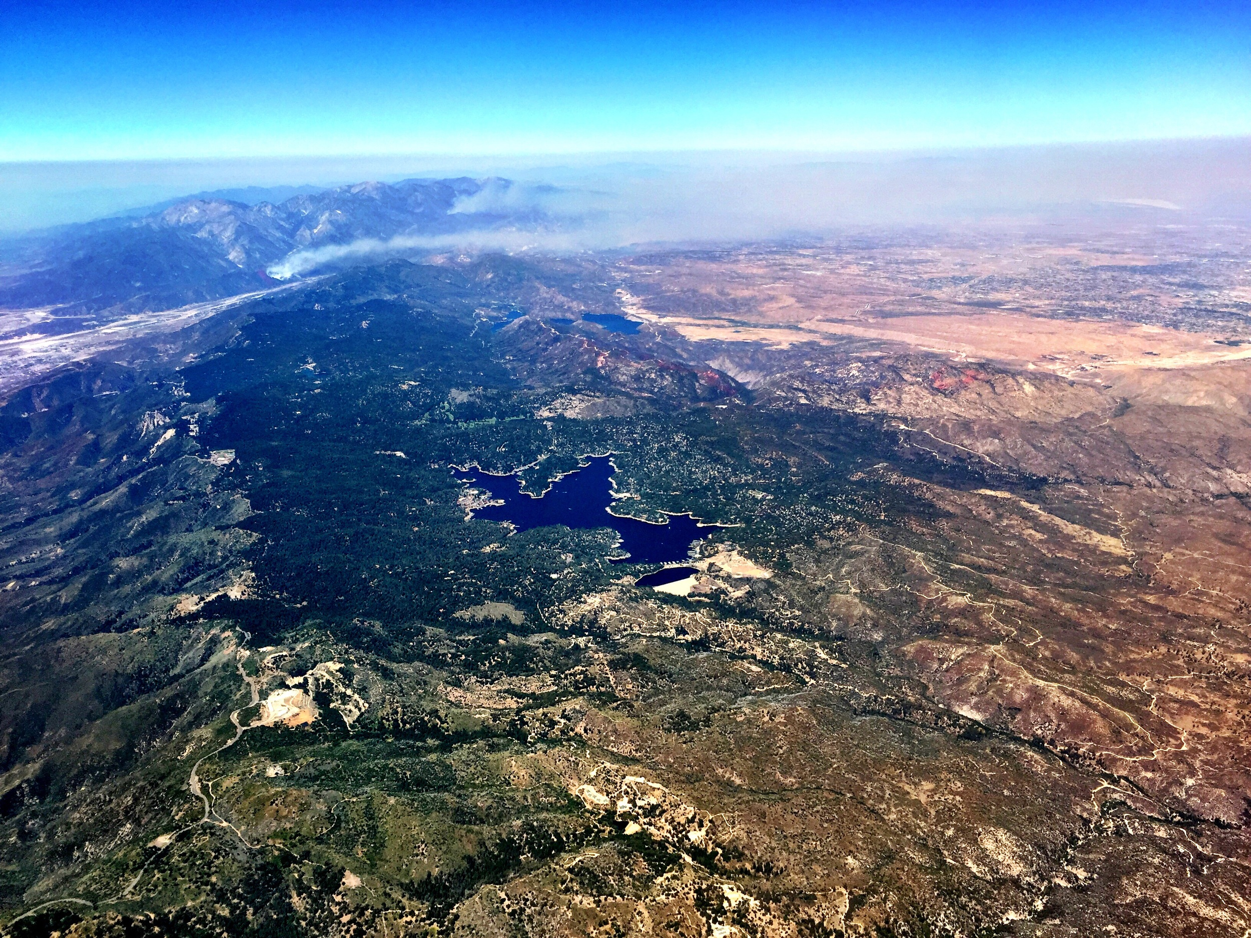 Over Running Springs, California, with a view of wildfires on the mountain, at 1:52 PM.