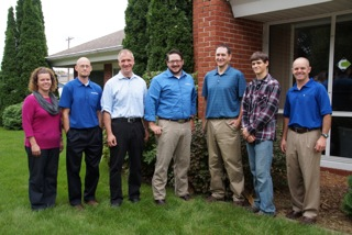 ALL MOVED IN--Employees at Cloudpoint Geographic, Inc. are: (left to right)Jodi Hoffman, Paul Stephenson, Micah Williamson, Joe Christian, Matt Junker, Tyler Severson, and Jonathan Hodel