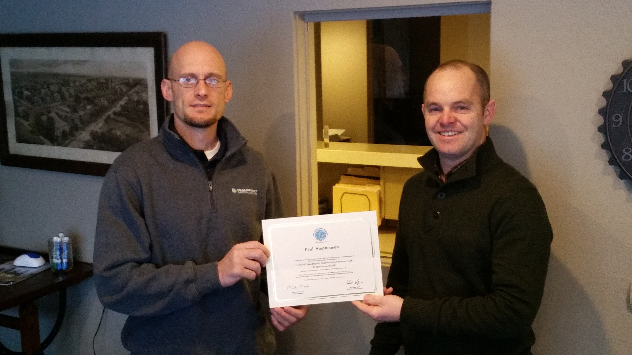Pictured are Paul Stephenson (left) and Jon Hodel (right) with Paul's new GISP certification